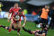 Gareth Davies of the Scarlets barges past Dan Evans (15) of the Ospreys to set up the 1st half try from DTH Van Der Merwe of Scarlets..Guinness Pro12 rugby match, Ospreys v Scarlets at the Liberty Stadium in Swansea, South Wales on Saturday 26th March 2016.<br /> pic by  Andrew Orchard, Andrew Orchard sports photography.