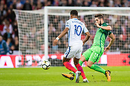 England (7) Raheem Sterling, Slovenia (17)Miha Mevlja during the FIFA World Cup Qualifier match between England and Slovenia at Wembley Stadium, London, England on 5 October 2017. Photo by Sebastian Frej.