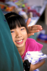 Stock photo of a young girl with a missing tooth.