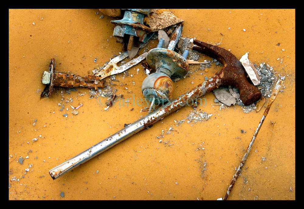 10th December, 2005. Aftermath of Hurricane Katrina, New Orleans, Louisiana. Gentilly. A discarded survivor's hammer used to smash through an attic to freedom during the storm.