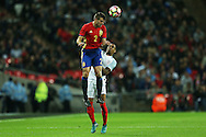 Cesar Azpilicueta of Spain heads the ball over Nathaniel Clyne of England. England v Spain, Football international friendly at Wembley Stadium in London on Tuesday 15th November 2016.<br /> pic by John Patrick Fletcher, Andrew Orchard sports photography.