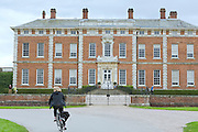A tourist is cycling near Beningbrough Hall, Yorkshire, England, United Kingdom.