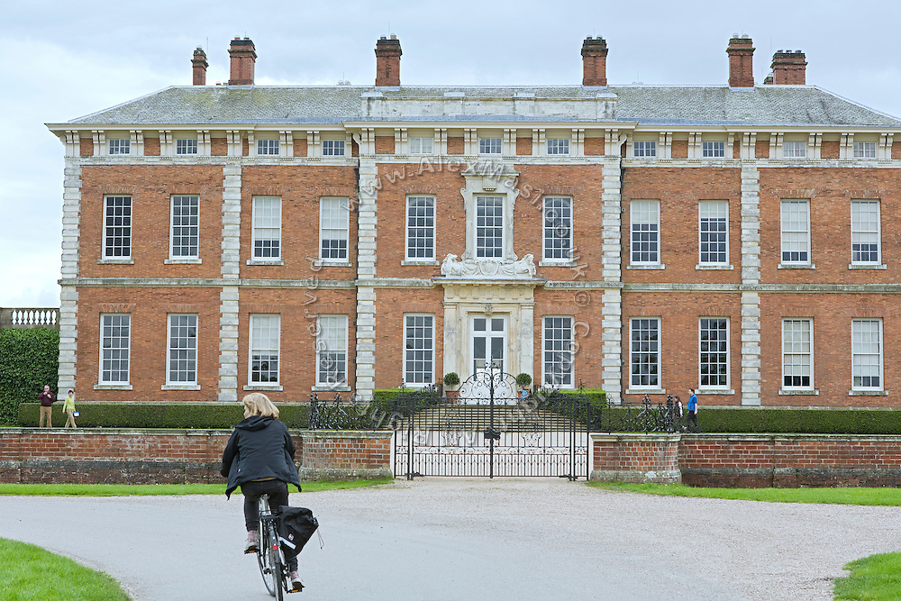 A tourist is cycling near Beningbrough Hall, Yorkshire, England, United Kingdom.
