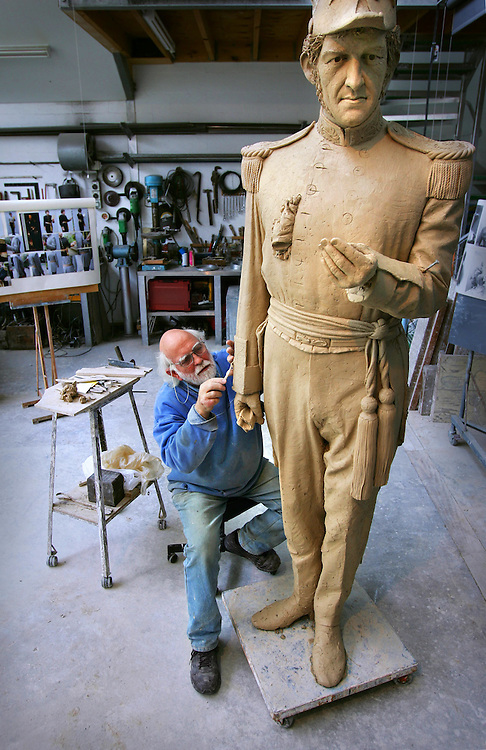 Sculptor Peter Corlett working on his statue of Governor LaTrobe to go on the forecourt of the state library  Pic By Craig sillitoe SPECIALX 000 melbourne photographers, commercial photographers, industrial photographers, corporate photographer, architectural photographers, This photograph can be used for non commercial uses with attribution. Credit: Craig Sillitoe Photography / http://www.csillitoe.com<br /> <br /> It is protected under the Creative Commons Attribution-NonCommercial-ShareAlike 4.0 International License. To view a copy of this license, visit http://creativecommons.org/licenses/by-nc-sa/4.0/.