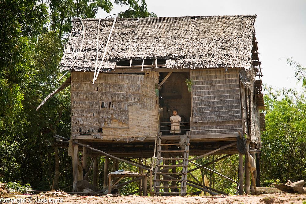 17 MARCH 2006 - KAMPONG CHHNANG, KAMPONG CHHNANG, CAMBODIA: Traditional Cambodian thatched homes along the Tonle Sap River near the city of Kampong Chhnang in central Cambodia. Photo by Jack Kurtz