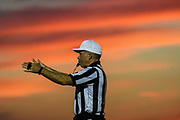 A referee makes a signal after a play during the football game between the Mount Mansfield Cougars and the BFA St. Albans Bobwhites at BFA High School on Friday night September 7, 2018 in St. Albans. (BRIAN JENKINS/for the FRESS PRESS)