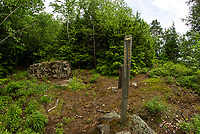 The Moon Trail marker located by what remains of Isabella Curtis' summer camp built in 1904 and destroyed by lightning in 1984.  (Karen Bobotas/for the Laconia Daily Sun)