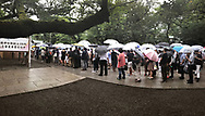 August 15, 2017, Tokyo, Japan: Today on the 72nd anniversary of the end of World War II, tens of thousand came out in the rain to pay their respects for Japan's war dead at Tokyo's Yasukuni Shrine, the national Shinto shrine where nearly 2.5 million war dead from the past 150 years are enshrined. Visits to Yasukuni by top Japanese politicians continue to outrage China and South Korea because it honors 14 World War II class A war criminals who are also enshrined there. Even so, dozens of Japanese lawmakers visited Yasukuni Shrine today, while PM Shinzo Abe sent a ritual offering via his emissary. Photo by Torin Boyd.