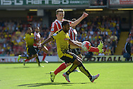 Ikechi Anya of Watford is challenged by Matt Targett of Southampton. Barclays Premier League, Watford v Southampton at Vicarage Road in London on Sunday 23rd August 2015.<br /> pic by John Patrick Fletcher, Andrew Orchard sports photography.