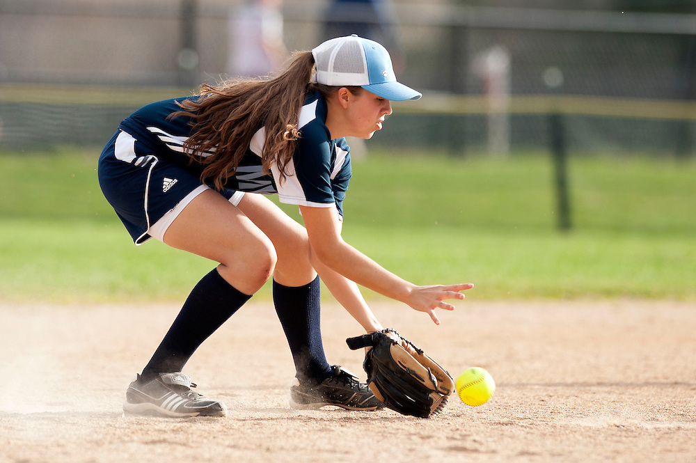 MMU's Felicia Forsyth fields the ground ball during the girls softball game between BFA-St. Albans and Mount Mansfield at MMU High School on Thursday afternoon May 8, 2014 in Jericho, Vermont. (BRIAN JENKINS, for the Free Press)