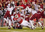Nov 5, 2011; Fayetteville, AR, USA;  Arkansas Razorback tight end Chris Gragg (80) is brought down by South Carolina Gamecock safety DeVonte Holloman (21) as cornerback Stephon Gilmore (5) makes a block during a game at Donald W. Reynolds Stadium.  Mandatory Credit: Beth Hall-US PRESSWIRE