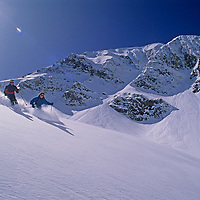 SKIING, Big Sky MT, Meg O'Leary & Sinuhe (MR) ski powder below Lone Mt.