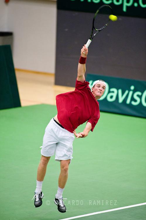 18.09.2015. Odense, Denmark. <br /> Mikael  Torpegaard of Denmark serves against Rafael Nadal of Spain during their Davis Cup match.<br /> Photo: © Ricardo Ramirez.