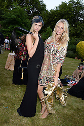 Left to right, CARA DELEVINGNE and POPPY DELEVINGNE at The Animal Ball in aid of The Elephant Family held at Lancaster House, London on 9th July 2013.