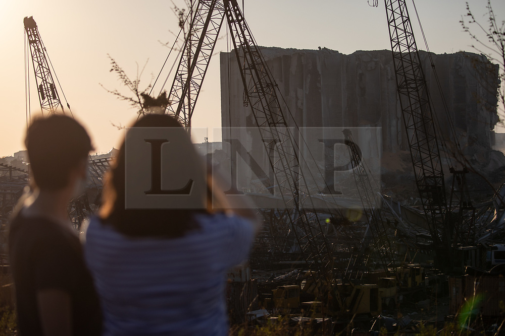 © Licensed to London News Pictures. 16/08/2020. Beirut, Lebanon. People look at the blast site in in Beirut Port, following a huge explosion on 4 August. Photo credit : Tom Nicholson/LNP