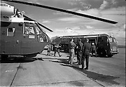 26/06/1963<br /> 06/26/1963<br /> 26 June 1963<br /> Irish Shell and BP fuel tankers for the helicopters of President John F. Kennedy under guard at Dublin Airport. View of one of the helicopters, a U.S. Army  Sikorsky VH-3A Sea King, being refuelled by a Shell and BP Leyland tanker. Crew names visible on airframe are SFC Stone and SGT White.