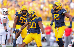 Oct 2, 2021; Morgantown, West Virginia, USA; West Virginia Mountaineers defensive lineman Akheem Mesidor (90) celebrates after a sack during the third quarter against the Texas Tech Red Raiders at Mountaineer Field at Milan Puskar Stadium. Mandatory Credit: Ben Queen-USA TODAY Sports