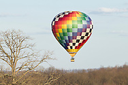 Middletown, New York - A hot air balloon flies over the trees after taking off from Randall Airport on April 12, 2014.