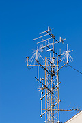 Yagi and discone communications antennas on triangular lattice tower for UHF and VHF wireless monitoring and surveillance station with direction finding. <br /> <br /> Editions:- Open Edition Print / Stock Image