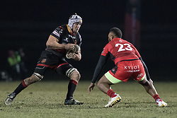 Dragons' Ollie Griffiths charges at Edinburghs' Junior Rasolea.<br /> <br /> Photographer Simon Latham/Replay Images<br /> <br /> Guinness PRO14 - Dragons v Edinburgh - Friday 23rd February 2018 - Eugene Cross Park - Ebbw Vale<br /> <br /> World Copyright © Replay Images . All rights reserved. info@replayimages.co.uk - http://replayimages.co.uk