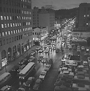 Y-581226A-06. Night view of SW 6th looking south from Yamhill. December 26, 1958.