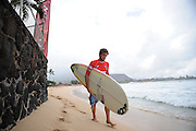 November 3rd  2010: Harley Ingleby makes his way to the line up for his round 1  heat of the ASP World Longboard Championship at Makaha Oahu-Hawaii. Photo by Matt Roberts/mattrIMAGES.com.au
