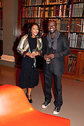 RENI FOLAWIYO; DAVID ADJAYE, Outset dinner 2011.  Organised by Yana Peel supported by Swarovskito raise funds for the V+A to starts its contemporary design collection. V & A. London. 23 March 2011. -DO NOT ARCHIVE-© Copyright Photograph by Dafydd Jones. 248 Clapham Rd. London SW9 0PZ. Tel 0207 820 0771. www.dafjones.com.