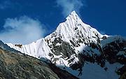 Paria peak (18,400 feet) rises sharply above the Santa Cruz Trek, in Huascaran National Park, Cordillera Blanca Mountains, Huaraz, Peru. UNESCO honored Huascaran National Park on the World Heritage List in 1985. Cordillera Blanca mountain range is in the Sierra Central of the Peruvian Andes.