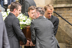 © Licensed to London News Pictures. 27/08/2015. Bury, UK.  Picture shows Gary & Phil Neville carrying their father coffin. The funeral of Neville Neville father of footballers Gary & Phil Neville & England net ball coach Tracey has taken place today at Bury Parish church. Neville died in Australia after being taken ill on a visit to support his daughter  Tracey.  Photo credit: Andrew McCaren/LNP