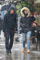 © Licensed to London News Pictures. 04/06/2021. London, UK. A couple are caught out during rainfall in north London. According to The Met Office, more rain is expected today across London and the South East of England, with the hot weather returning tomorrow. Photo credit: Dinendra Haria/LNP