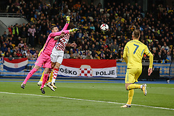 October 9, 2017 - Kiev, Ukraine - Andriy Yarmolenko (R) and Sime Vrsaljko of Ukraine, in action against Croatian goalkeeper Danijel Subasic (C) during the FIFA 2018 World Cup Group I Qualifier between Ukraine and Croatia at Kiev Olympic Stadium on October 9, 2017 in Kiev, Ukraine. Ukraine fail to reach the play-offs as they lose 2-0. (Credit Image: © Sergii Kharchenko/NurPhoto via ZUMA Press)