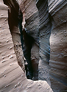 Dark and foreboding convoluted passageway of Spooky Gorge slot canyon, Grand Staircase-Escalante National Monument, Utah.