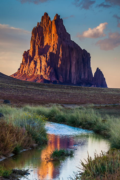 Known as Shiprock, this 1700-foot eroded volcanic plume is sacred to the Navajos as Tse Bi dahi, or the Rock with Wings. The name comes from an ancient folk myth that tells how the rock was once a great bird that transported the ancestral people of the Navajos to their lands in what is now northwestern New Mexico. Geologists tell us this mountain was formed by a volcanic vent 27 million years ago. Shiprock is the world's finest example of an exposed volcanic throat. It can be seen for 100 miles.