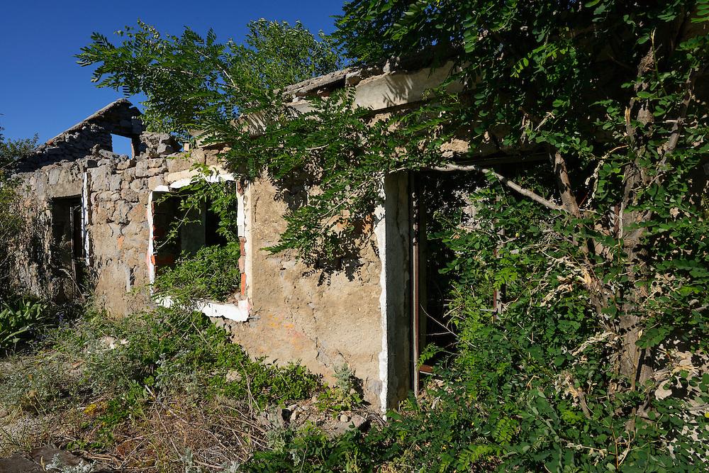 House ruins, abandoned since the Balkan war  1991-1995, Velebit Nature Park, Rewilding Europe rewilding area, Velebit  mountains, Croatia