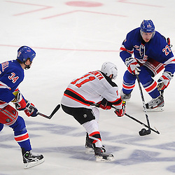 May 16, 2012: New York Rangers defenseman Ryan McDonagh (27) pokes the puck away from New Jersey Devils right wing Stephen Gionta (11) during third period action in game 2 of the NHL Eastern Conference Finals between the New Jersey Devils and New York Rangers at Madison Square Garden in New York, N.Y. The Devils defeated the Rangers 3-2.