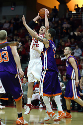 30 January 2007: Levi Dyer catches Bradley Strickland looking the other way and takes a shot. The Purple Aces of Evansville folded the final 2 minutes of play and handed the game to Illinois State University Redbirds by a score of 65-61at Redbird Arena in Normal Illinois.