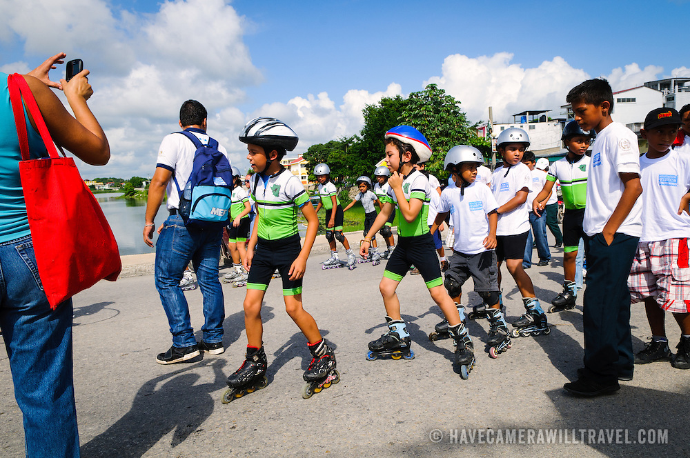 A group of boys on rollerblades participate in the Guatemalan Independence Day procession on 15 September 2011. Groups of school students parade in a procession through the streets of Flores, starting in the Parque Central, walking through the town, and crossing the causeway into Santa Elena.