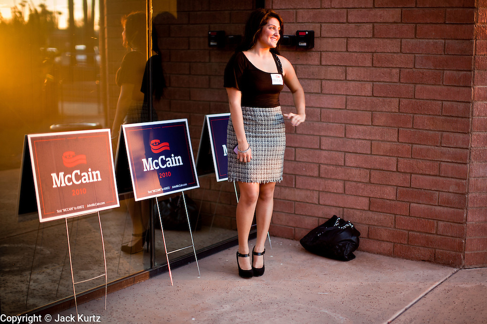 Aug. 23, PHOENIX, AZ: A woman has her picture made with yard signs for Sen John McCain at his campaign offices in Phoenix Monday. US Sen. John McCain held the final of his primary election campaign at his campaign offices in Phoenix Monday. McCain, Arizona's senior Republican US Senator, is facing former Congressman JD Hayworth in the primary, Tuesday, Aug. 24. McCain has outspent Hayworth by a considerable margin and is expected to win.   Photo by Jack Kurtz