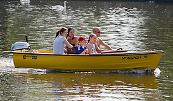 © licensed to London News Pictures. 19/04/2011.  Windsor, UK. A family enjoy a boatride in sunshine in Windsor, Berkshire as temperatures in the UK hit 25 degrees. Please see special instructions for usage rates. Photo credit should read Ben Cawthra/LNP