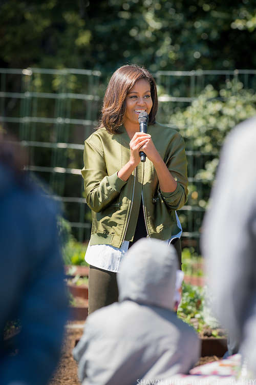 First Lady Michelle Obama addresses students about the importance of eating vegetables and exercising to stay healthy.