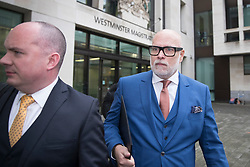 © Licensed to London News Pictures. 14/11/2017. London, UK. GARY GOLDSMITH (R), an uncle of the Duchess of Cambridge, leaves Westminster Magistrates Court. The younger brother of Kate Middleton's mother allegedly punched his wife, Julie-Ann Goldsmith, during a late night argument outside their west London home, following a night out.  Mr Goldsmith has pleaded guilty and will return for sentencing next week. . Photo credit: Peter Macdiarmid/LNP