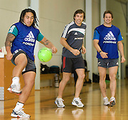 Ma'a Nonu, Conrad Smith and Richie McCaw during a game of soccer before the pool session. Rugby - All Blacks pool session at QEII pool, Christchurch. Monday 2 August 2010. Photo: Joseph Johnson/PHOTOSPORT