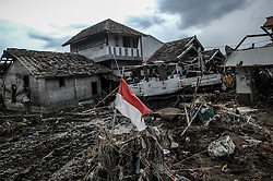 September 23, 2016 - Garut, Indonesia - Villagers save valuables in their homes on the Cimanuk river banks in Garut district, West Java province on September 23, 2016, two days after a series of landslides and flash floods hit several areas. The death toll from devastating floods and landslides in Indonesia has risen to 26, an official said, with hopes fading for 19 others still missing. (Credit Image: © Dasril Roszandi/NurPhoto via ZUMA Press)