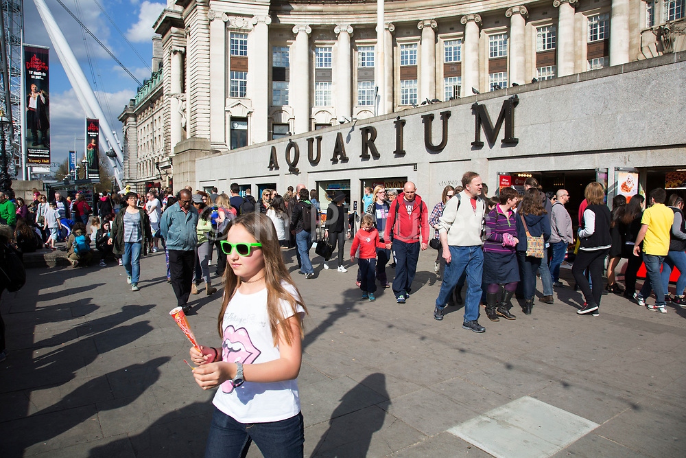 Busy tourist scene outside the London Aquarium. The South Bank is a significant arts and entertainment district, and home to an endless list of activities for Londoners, visitors and tourists alike.