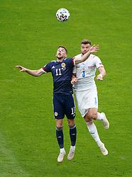 Scotland's Ryan Christie and Czech Republic's Ondrej Celustkar battle for the ball during the UEFA Euro 2020 Group D match at Hampden Park, Glasgow. Picture date: Monday June 14, 2021.