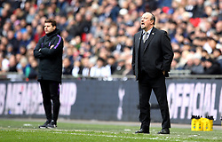 Newcastle United manager Rafael Benitez (right) and Tottenham Hotspur manager Mauricio Pochettino on the touchline during the Premier League match at Wembley Stadium, London.