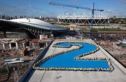 Olympic Park.  2 years to go. View of the F10 bridge with construction workers from the Aquatics Centre forming a giant number 2 to signify 2 years until the start of London 2012 Olympic Games.The Aquatics Centre and the Olympic Stadium are visible beyond. Picture taken on 21 Jul 10 by David Poultney. **STRICTLY EMBARGOED until 00.00 Tuesday 27th July