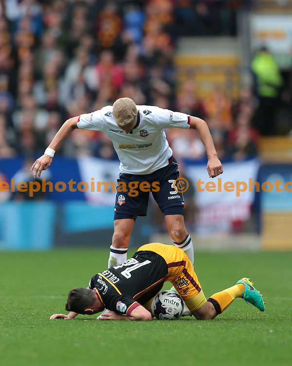 Bolton Wanderers defender Dean Moxey (3) tries to get the ball from Bradford City midfielder Josh Cullen (14) during the Sky Bet League 1 match between Bolton Wanderers and Bradford City at the Macron Stadium in Bolton. September 24, 2016.<br /> Nigel Pitts-Drake / Telephoto Images<br /> +44 7967 642437