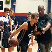 NBA basketball player Kobe BRYANT (R) and Turkish Basketball Club Anadolu Efes young team players durig their training at Anadolu Efes Sports Club at Istanbul, Turkey on 26 September 2011. Photo by TURKPIX