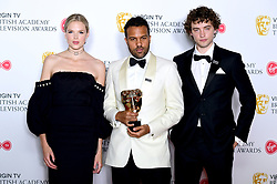 Presenters Gabriella Wilde and Josh Whitehouse (right) with winner of International for The Handmaid's Tale O-T Fagbenle pose in the press room at the Virgin TV British Academy Television Awards 2018 held at the Royal Festival Hall, Southbank Centre, London.